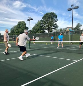 Image of men playing pickleball